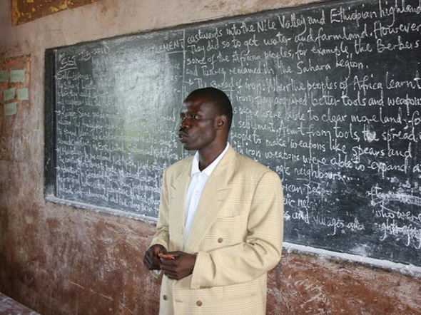 a teacher in front of his class