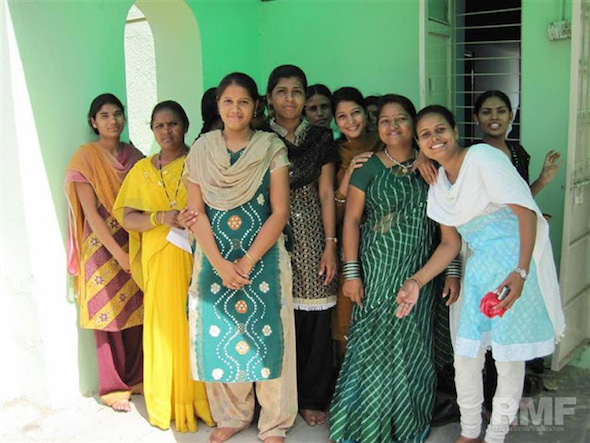 ladies in India pose for a photo