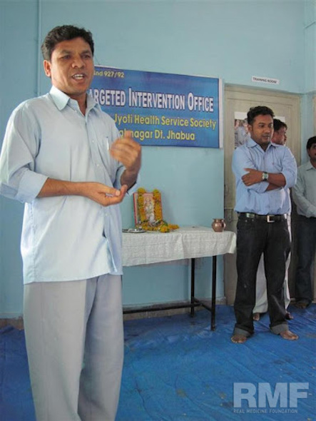 man giving a speech for ceremony