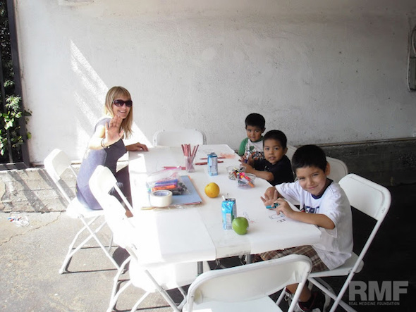children coloring at a table