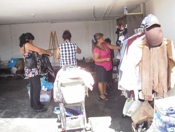 women sorting through donations