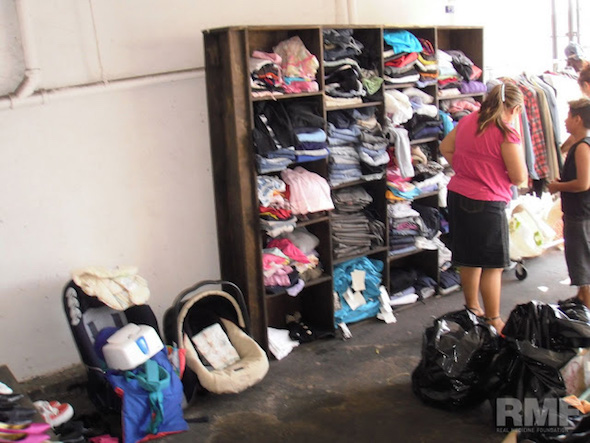 sorting through clothes donations