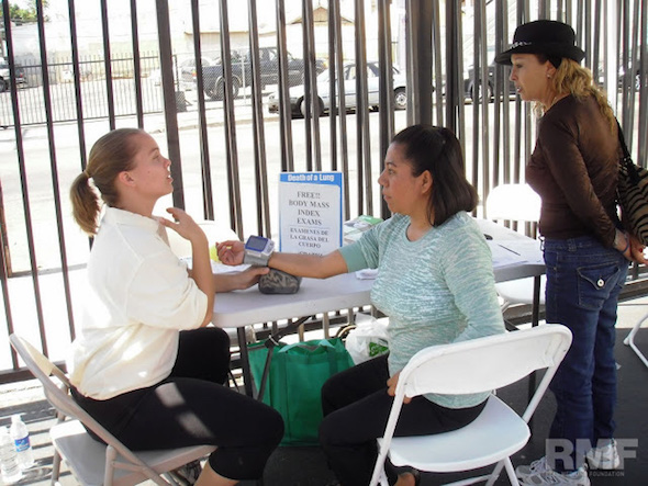 woman getting a blood pressure reading