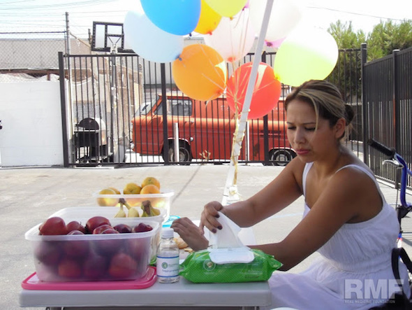 woman passing out fruits