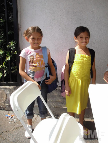 young girls pose with backpacks