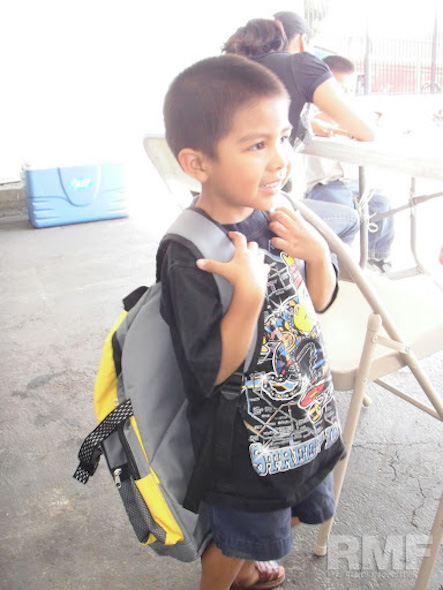 young boy with new backpack