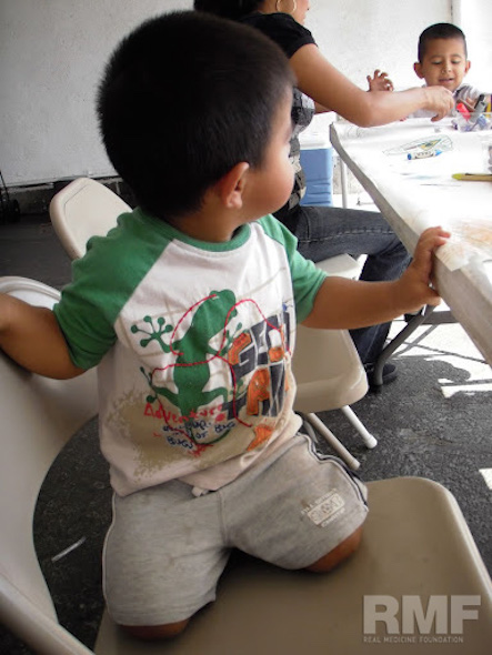 young boy at the coloring table