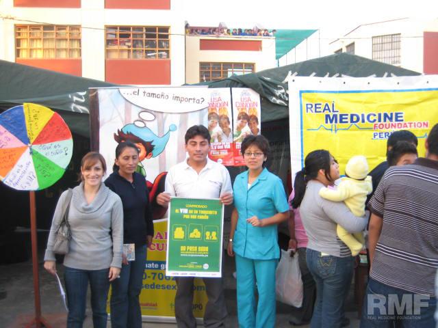 team presenting information at health fair