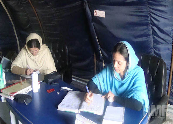 women doing paperwork