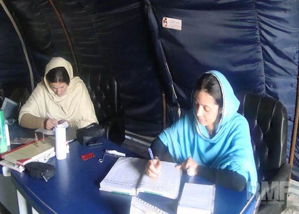women doing paperwork