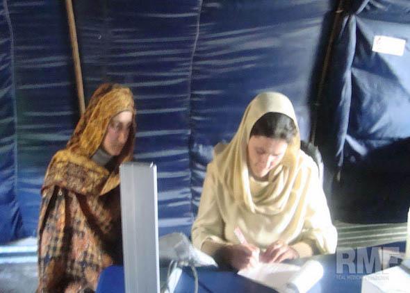 two women filling paperwork