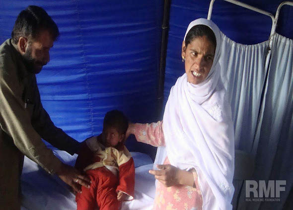 women assisting son with medical care