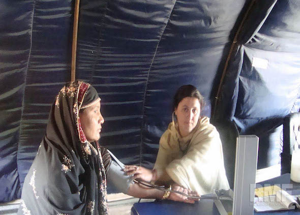 woman getting blood pressure checked