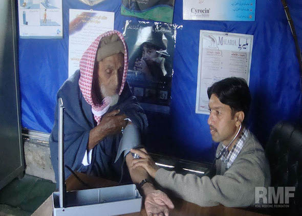 elderly man getting blood pressure reading