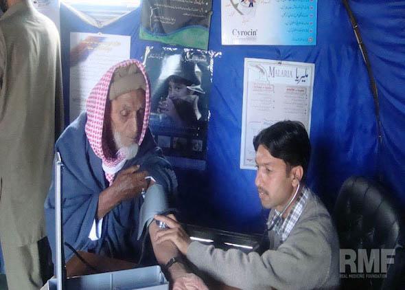 elderly man getting blood pressure reading