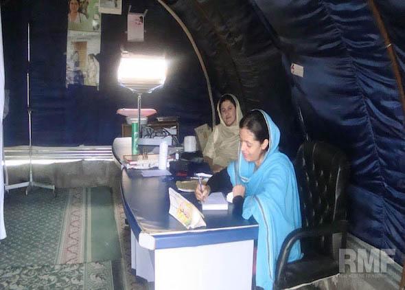 women completing medical paperwork