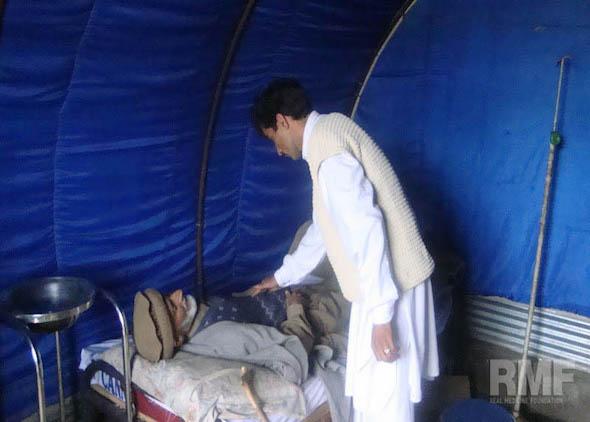 elderly man receiving medical care