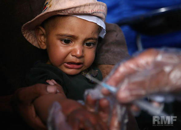 young child receives medication