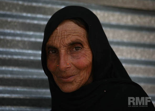 elderly woman poses for a photo