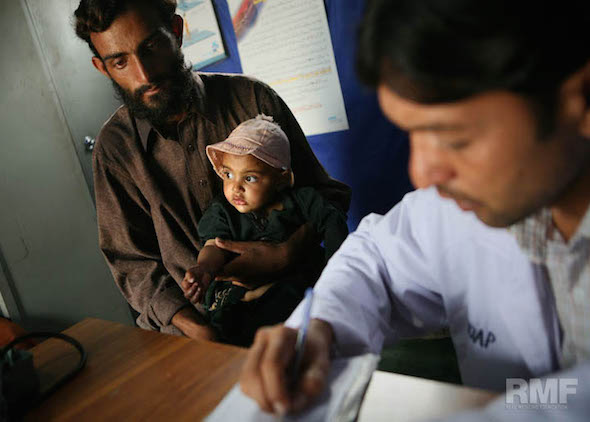 father and child wait for medical care