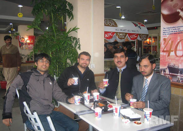 men pose for photo in kfc