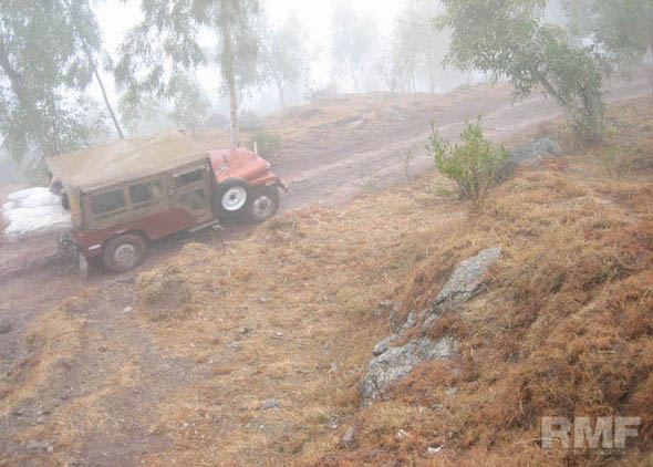 jeep following a foggy road