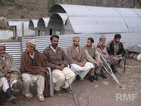 men waiting in pakistan