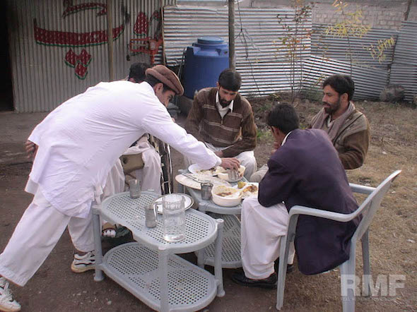 men dining together outside