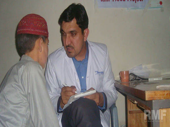 doctor talking to young boy