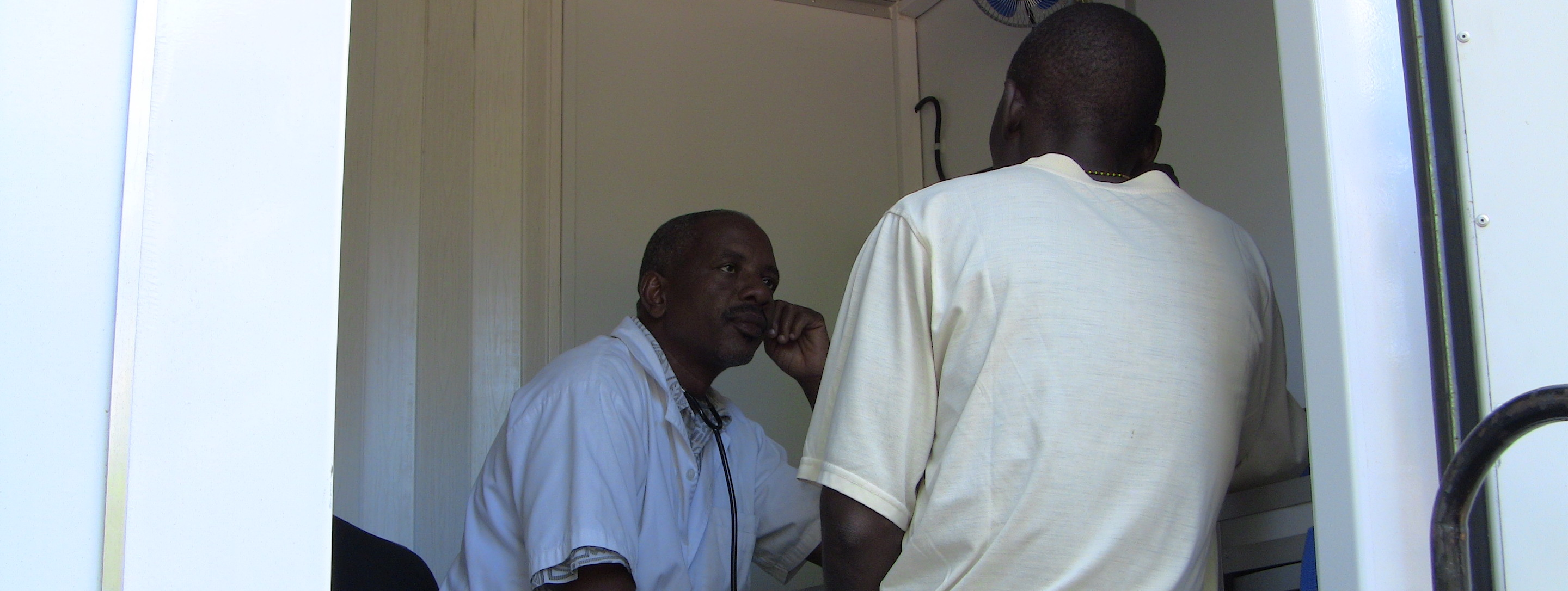 doctor and patient inside a mobile clinic