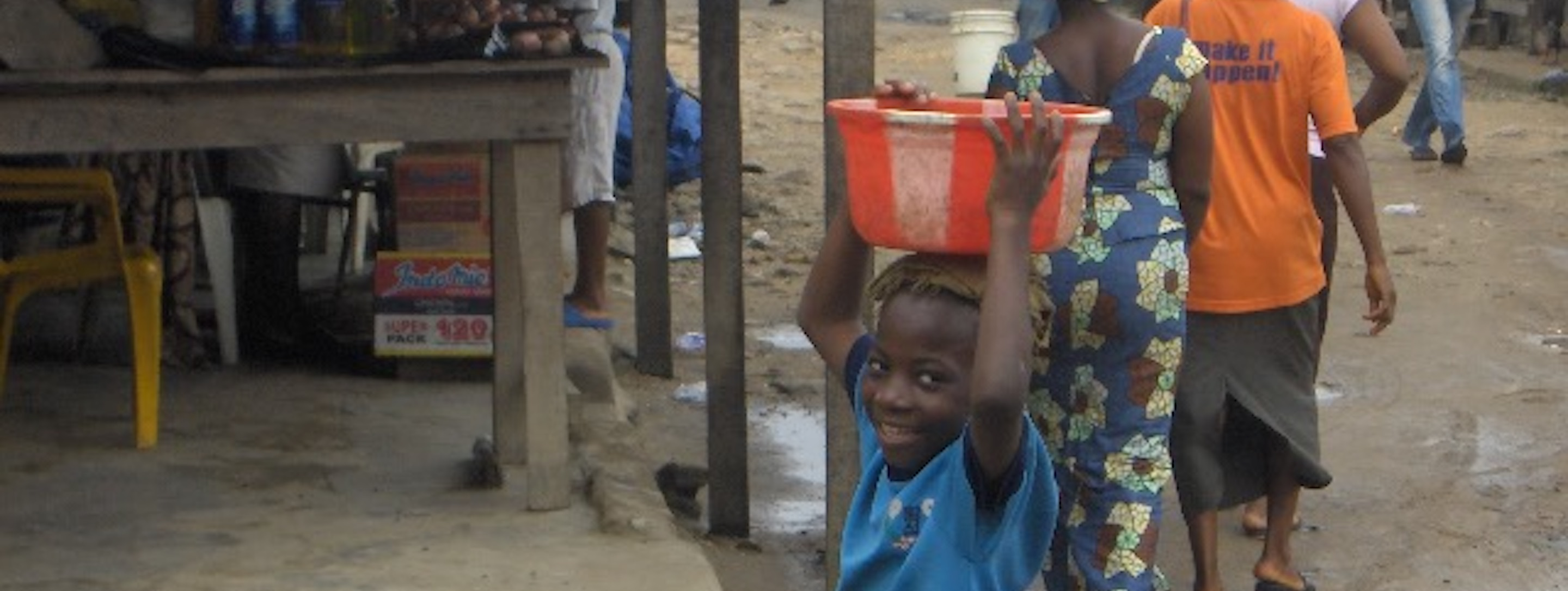 young boy smiling at the camera in nigeria