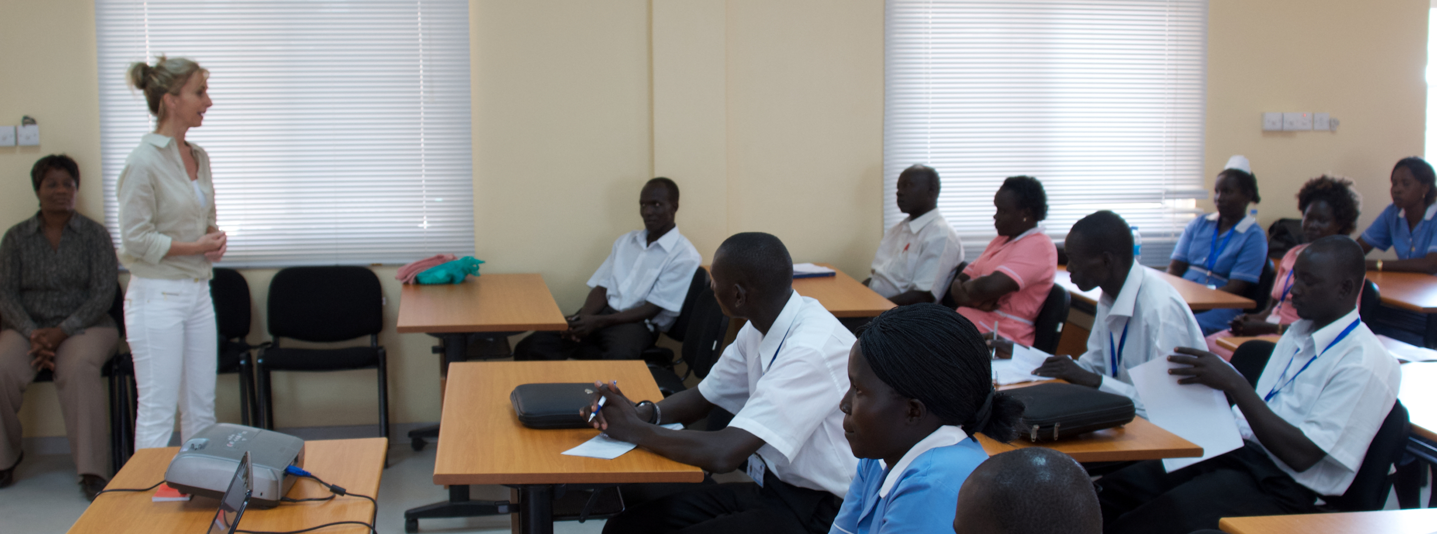woman speaking to a nursing class in south sudan