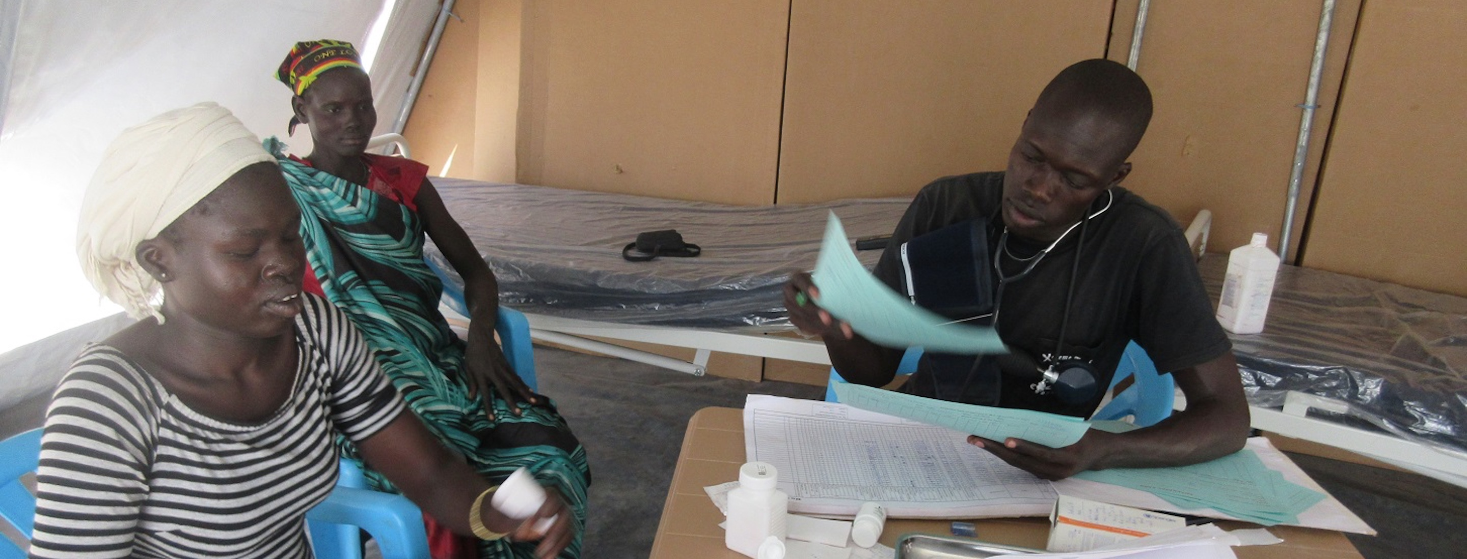 south sudanese doctor with patients