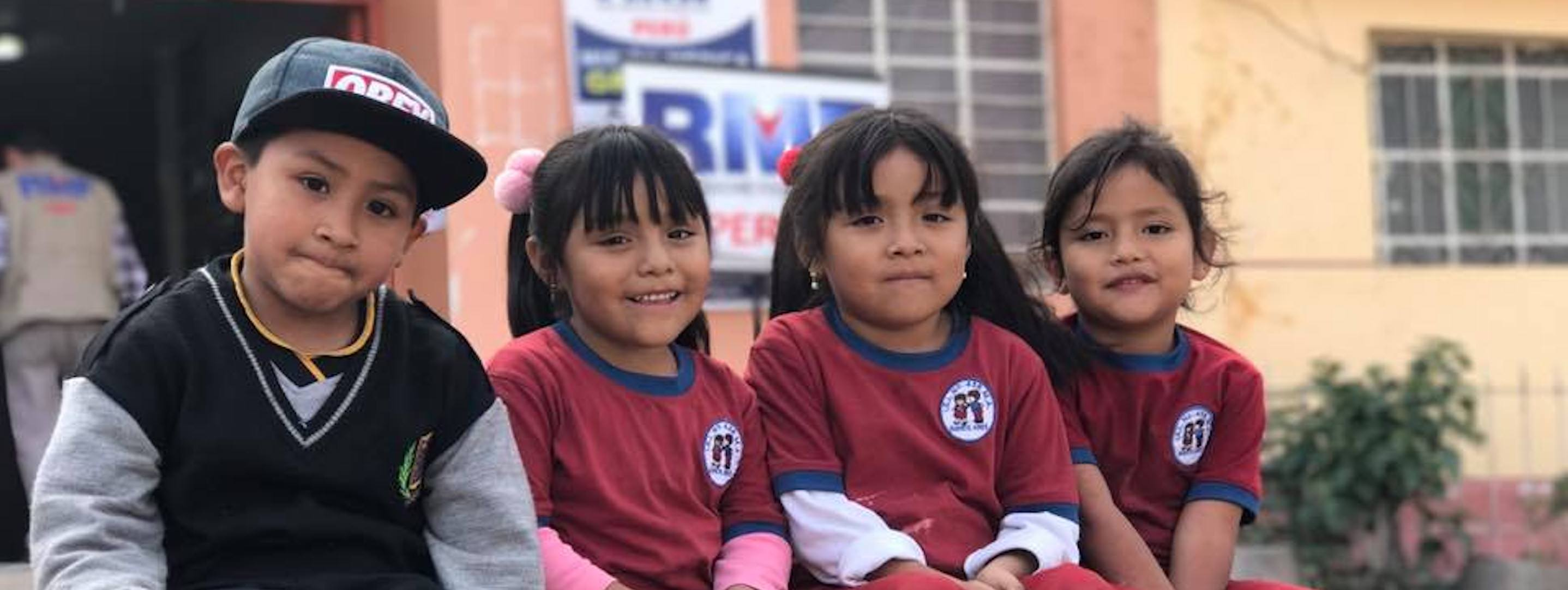 young peruvian children outside of school