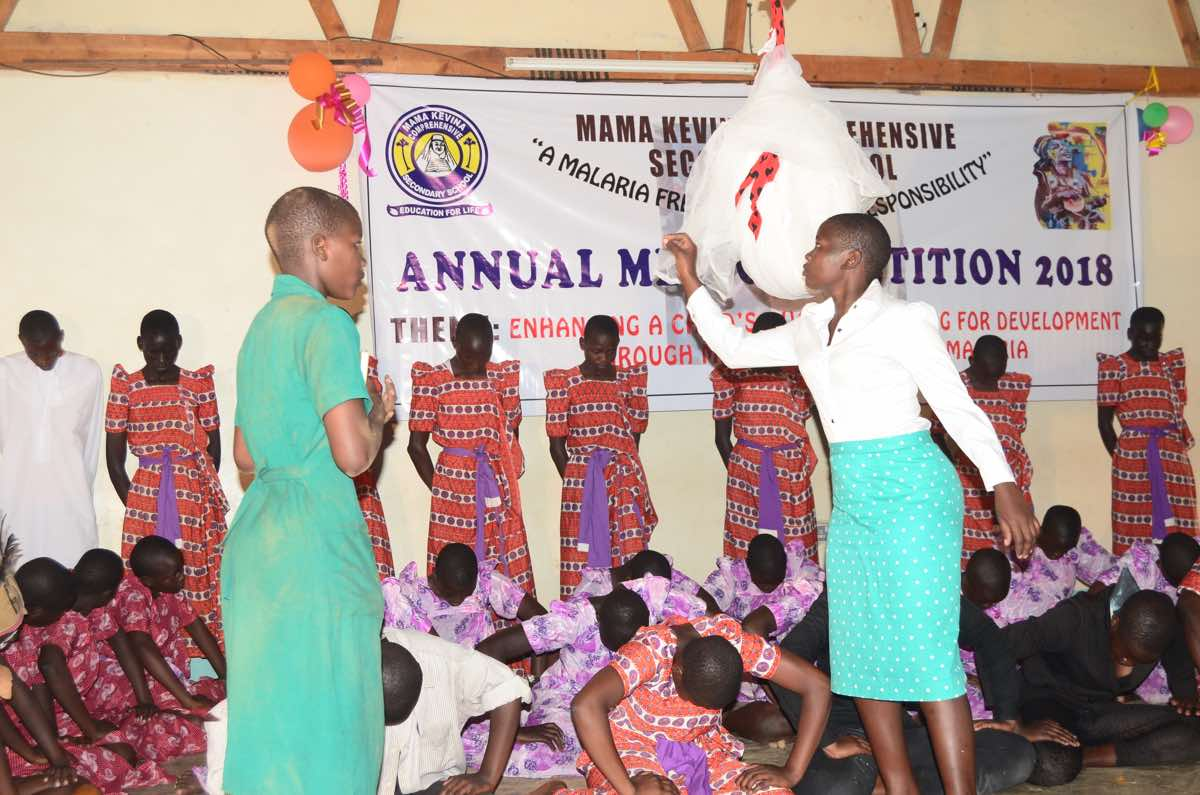 Students presenting a traditional dance from Busoga. The presentations are organized to be comprehensive and contribute to students' well-rounded education.