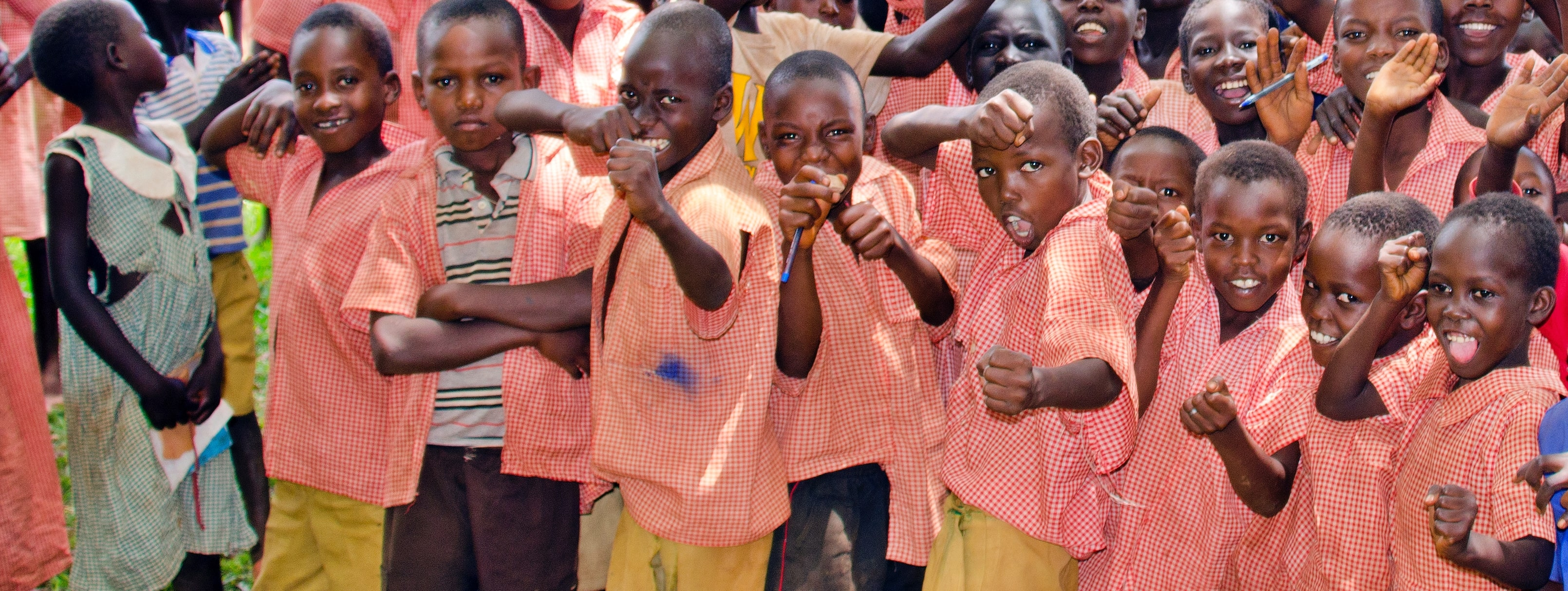 kiryandongo students laughing playing group